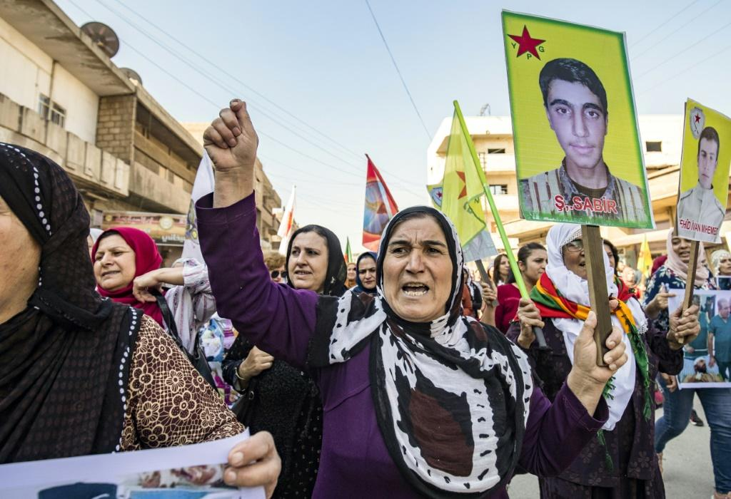 Syrian Kurds hold a protest in the town of Qamishli against the Turkish assault on northeastern Syria