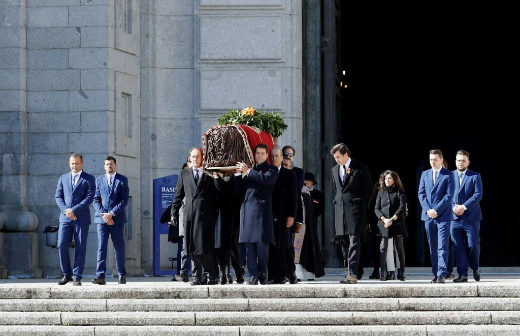 Eight family members carry the coffin of the late Spanish dictator Francisco Franco out of the basilica at the Valley of the Fallen ahead of its transfer to a more discreet burial site
