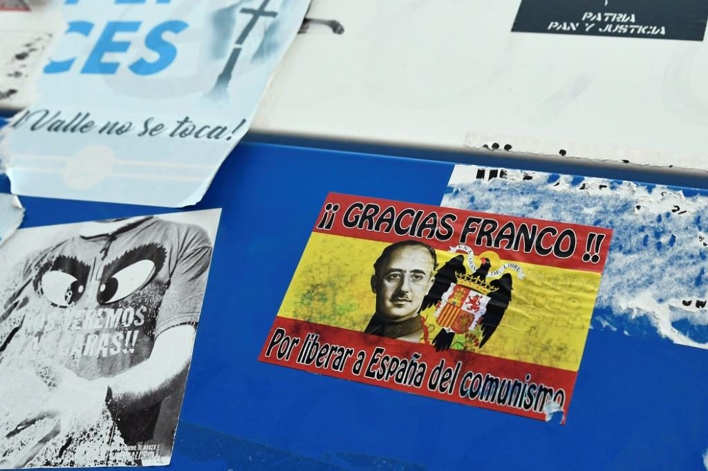 "Stickers and posters in support of the late dictator, one of which reads: ""Thank you Franco for saving Spain from communism"
