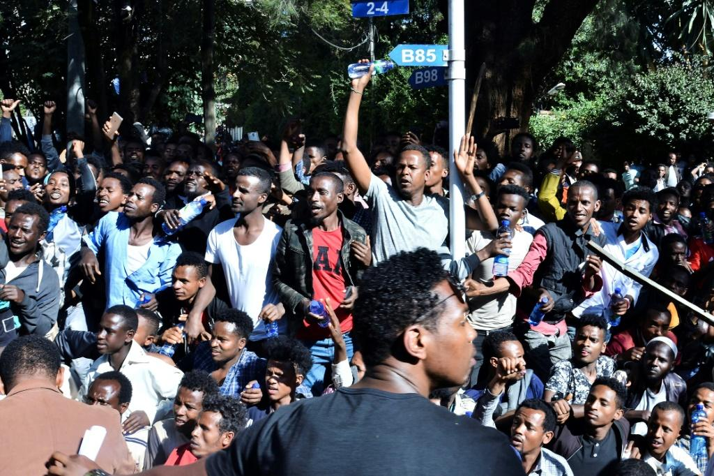 Supporters of Jawar Mohammed, a member of the Oromo ethnic group who has been a critic of Prime Minister Abiy Ahmed, gathered outside his home in Addis Ababa on Thursday after he accused security forces of trying to orchestrate an attack on him
