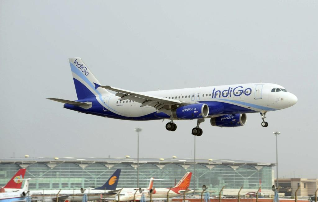 In this file photograph taken on June 24, 2010, an IndiGo Airbus A320 aircraft prepares for final approach at Indira Gandhi International Airport in New Delhi