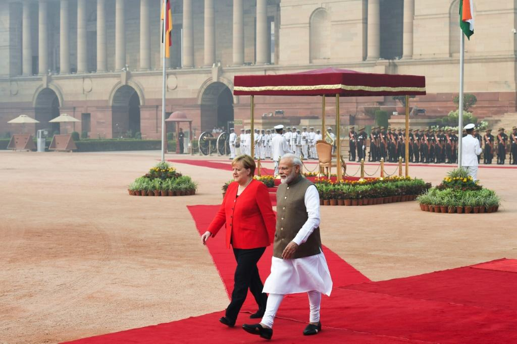 Neither Narendra Modi, nor visiting German Chancellor Angela Merkel, wore masks to protect themselves from the pollution choking Delhi