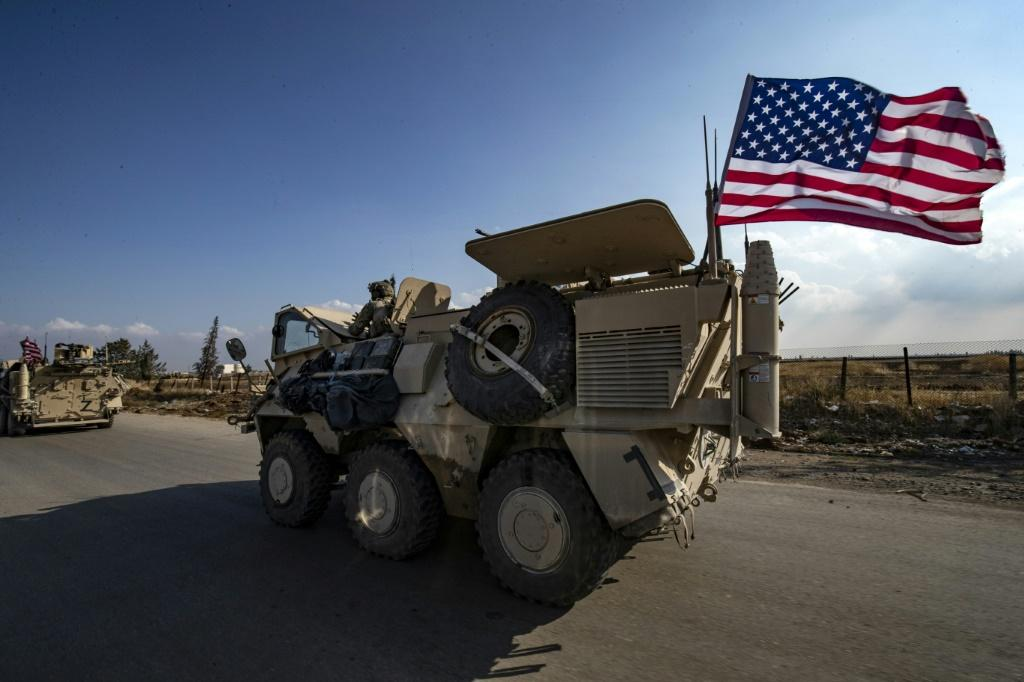 A convoy of US troops outside the Kurdish-majority city of Qamishli, in Syria's northeastern Hasakeh province on Saturday