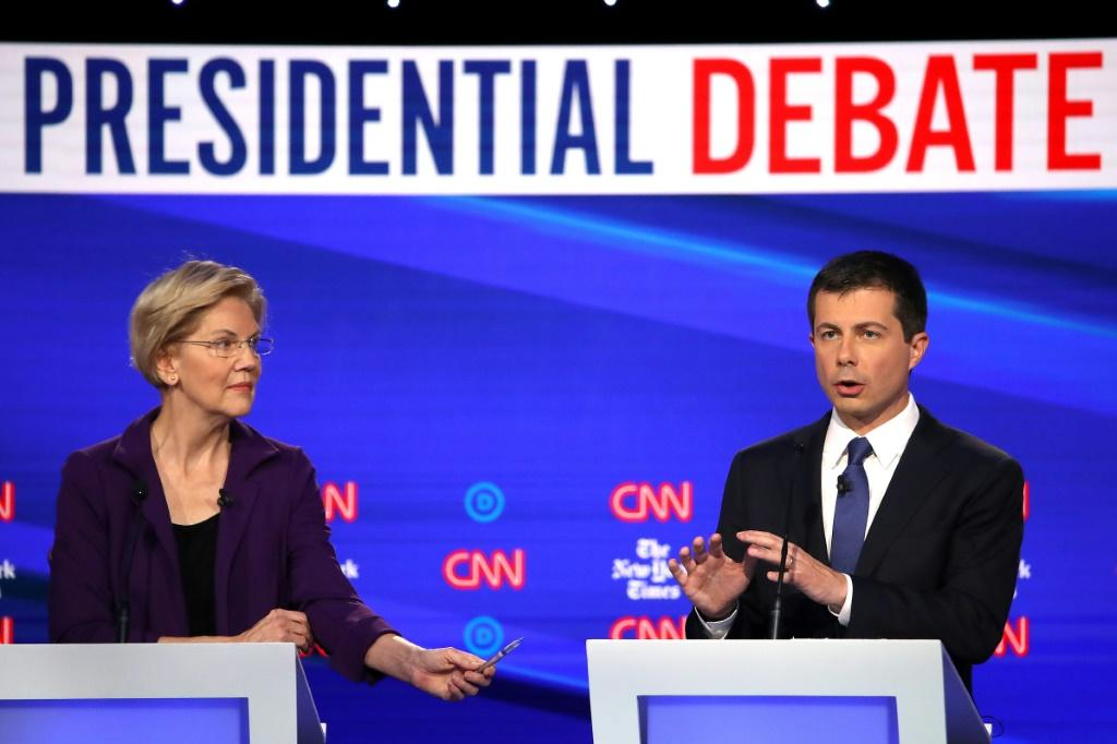 Senator Elizabeth Warren, seen here during a Democratic debate October 15, 2019 alongside South Bend, Indiana Mayor Pete Buttigieg, has surged to a lead in the early caucus state of Iowa