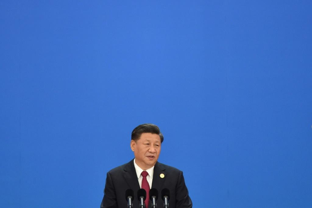 President Xi Jinping called on the world community to 'knock down walls instead of building walls'