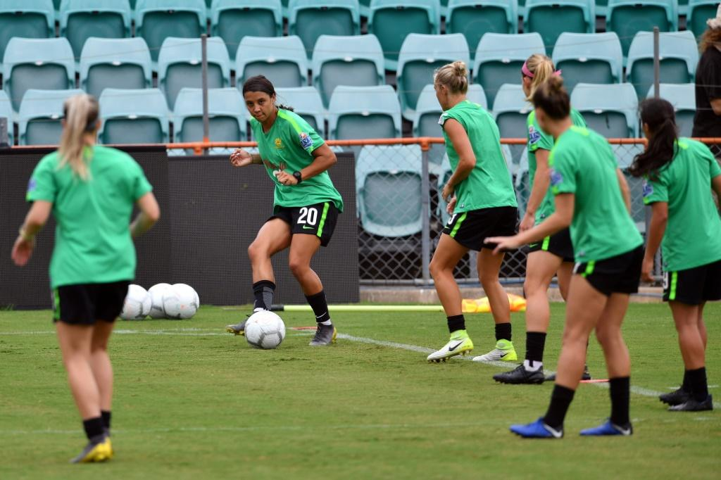 Australia's women footballers such as Sam Kerr, seen here kicking the ball during a Matildas training session, will earn the same as their male counterparts under a landmark deal