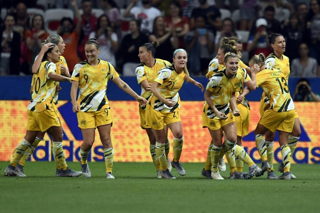 Landmark deal: The Matildas celebrate scoring against Norway in the last 16 at the World Cup in France this year. Now they will paid an equal amount as Australia's male national team footballers