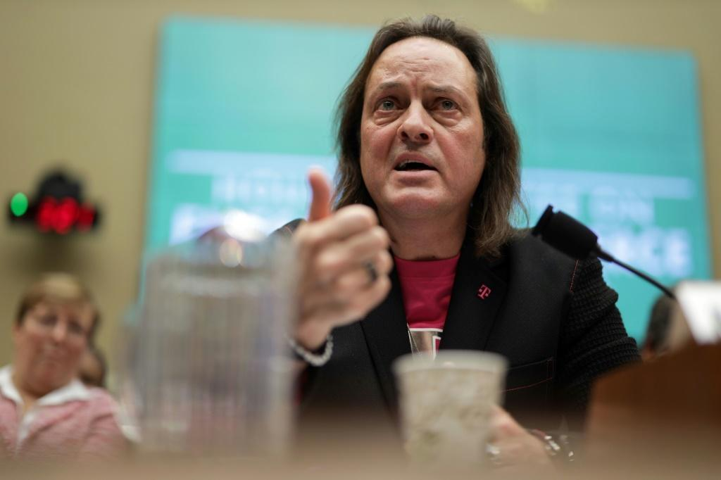 T-Mobile CEO John Legere, seen at a congressional hearing on the merger of the wireless carrier with rival Sprint, would head the new company after the tie-up is completed
