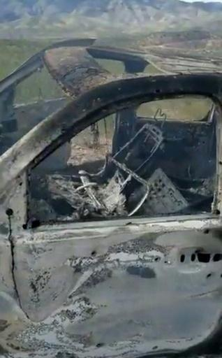 TV grab from a video published by Lebaron's family on social media showing a burnt vehicle that was carrying three women and six children from an American Mormon family near Rancho de la Mora, in northern Mexico, on November 4, 2019