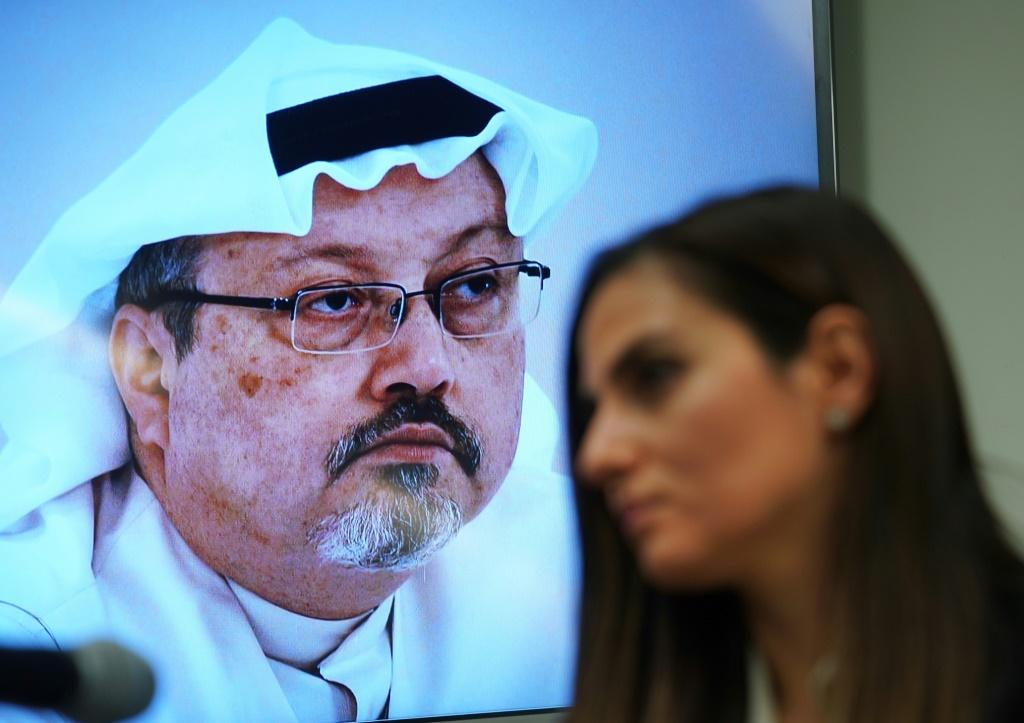 A picture of murdered Saudi journalist Jamal Khasshoggi (L), along with Sherine Tadros, head of the New York Office of Amnesty International
