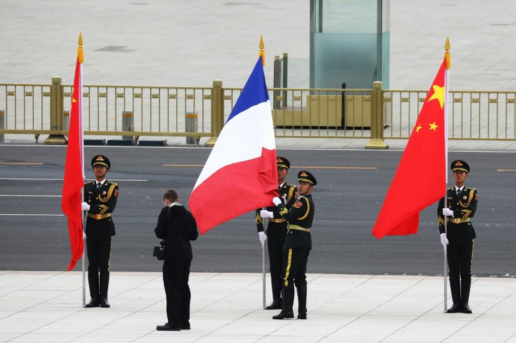 Chinese soldiers take part in a welcome ceremony for French President Emmanuel Macron