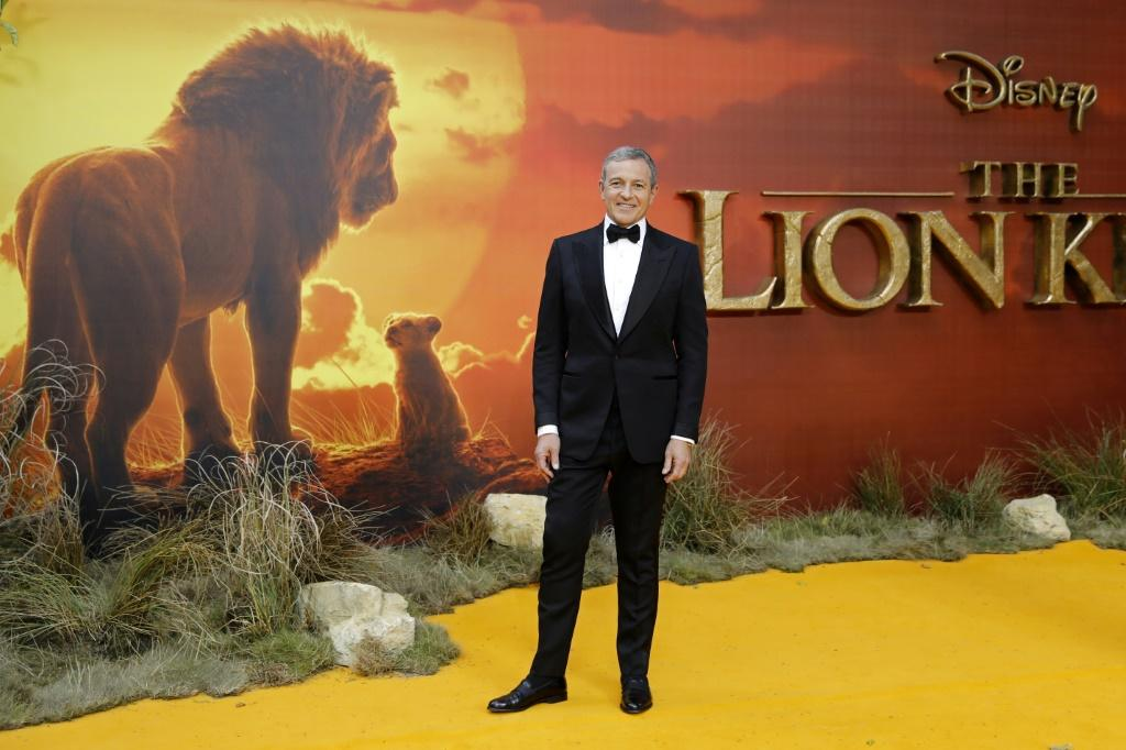 Disney CEO Robert Iger poses on the red carpet upon arriving for the European premiere of the film 'The Lion King,' which helped boost revenues for the entertainment giant in the past quarter