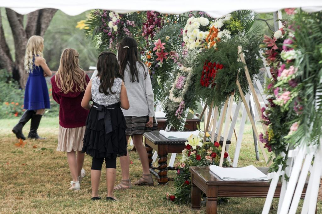 Girls attend the wake of the women and children killed in an attack authorities have blamed on a drug cartel