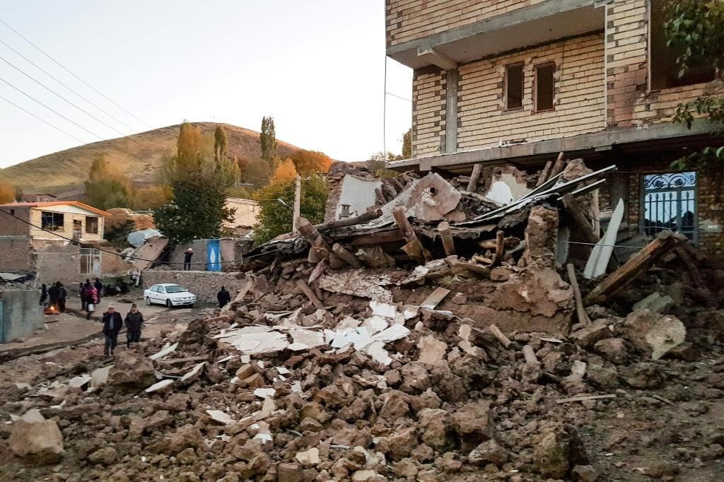 A pile of rubble is all that is left of one building in the village of Varnakesh after the pre-dawn quake which rocked northwestern Iran