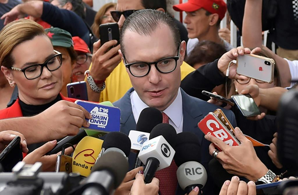 Cristiano Zanin (C) and Valeska Teixeira Zanin Martins, lawyers for Luiz Inacio Lula da Silva, spoke to journalists on November 8, 2019, after visiting the former Brazilian president at the Federal Police Headquarters in Curitiba