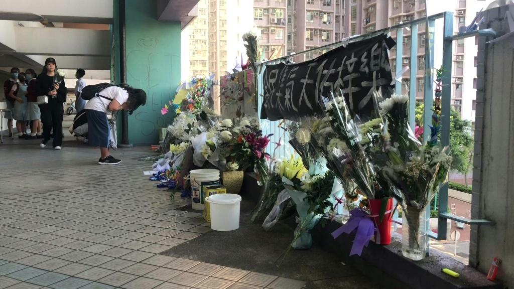 Hong Kongers mourn a student who died from a fall during recent protester clashes with police, triggering fresh outrage from the pro-democracy movement and fears of more violent unrest