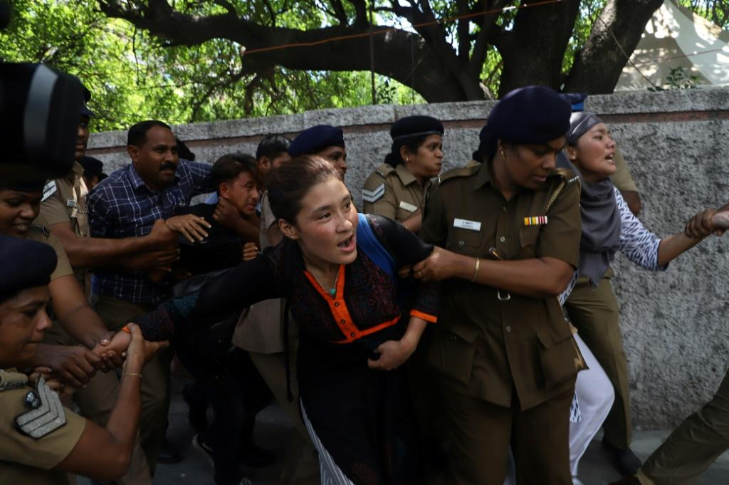 Indian police detain Tibetan students as they protest against the visit of China's President Xi Jinping in Chennai in October 2019