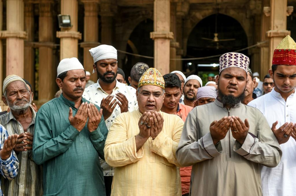 Muslims participate in a special prayer in Ahmedabad asking to maintain peace and harmony across India ahead of the Supreme Court ruling on the disputed religious site of Ayodhya