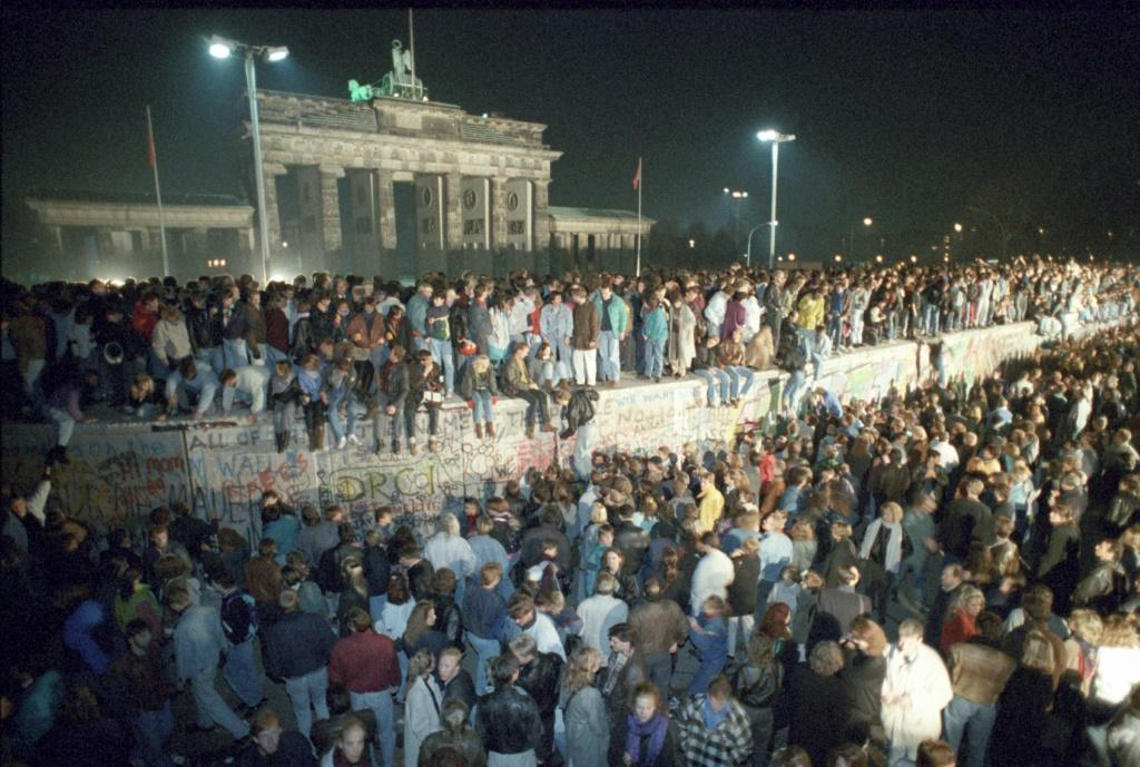 On November 9, 1989, East German border guards, overwhelmed by large crowds, threw open the gates to West Berlin, allowing free passage for the first time since it was built