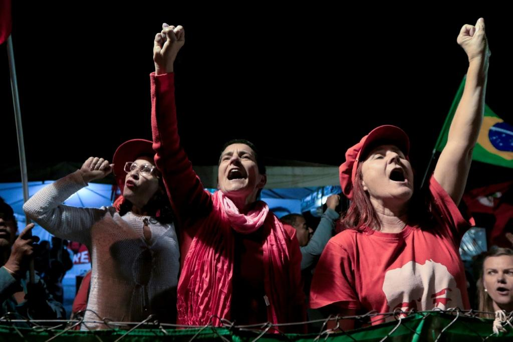 Supporters of former Brazilian President Luiz Inacio Lula da Silva celebrate a Supreme Court decision in Curitiba that could lead to his early release from prison