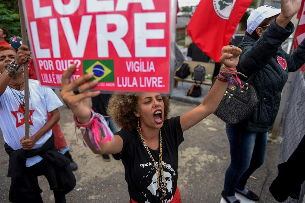 Supporters of former Brazilian President Luiz Inacio Lula da Silva celebrate a Supreme Court ruling that could benefit him, in front of the police headquarters where he is jailed in Curitiba on November 8, 2019