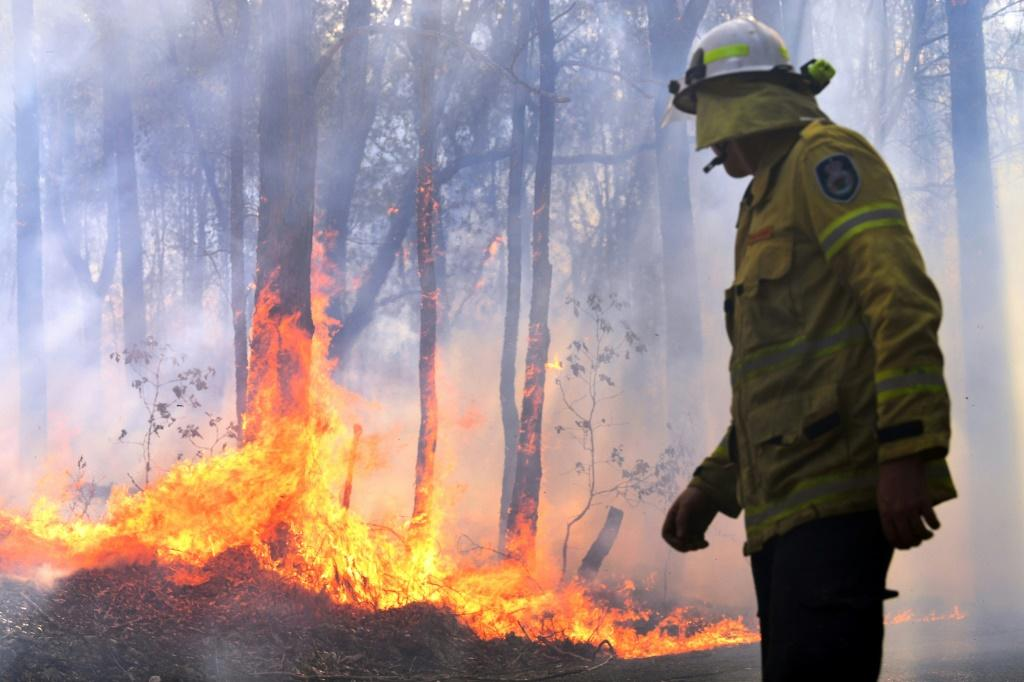 The government says the military could be called on to help some 1,300 firefighters who are tackling around 100 blazes