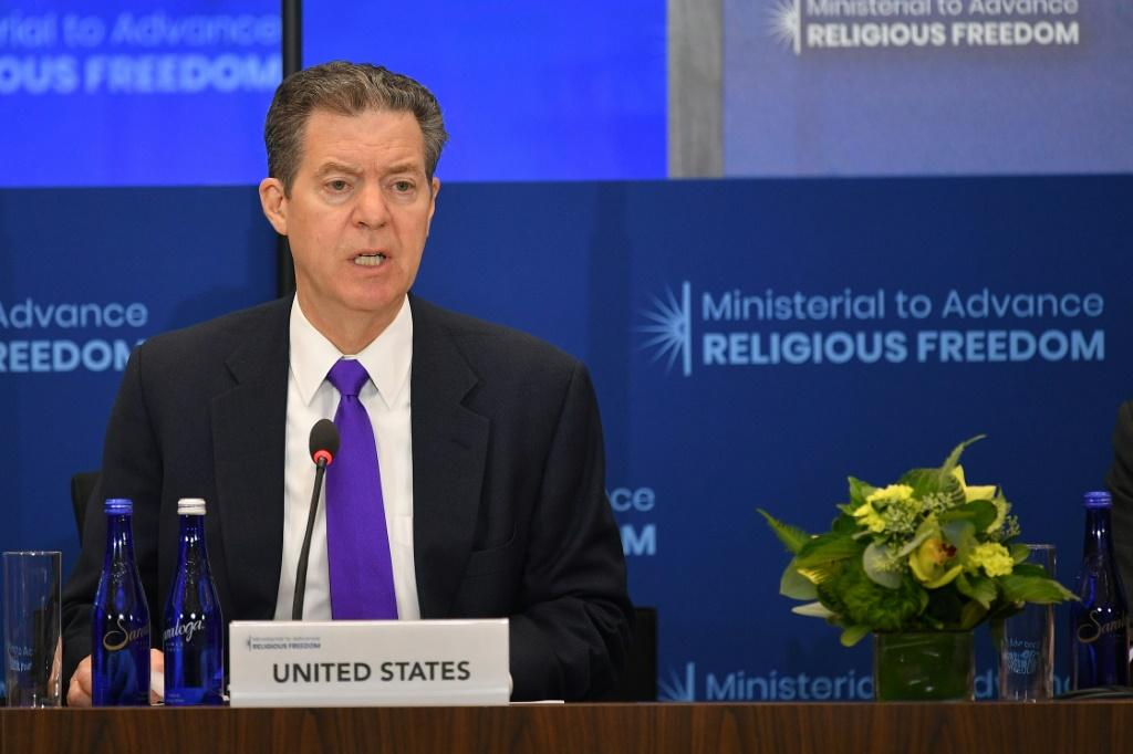 US religious freedom envoy Sam Brownback, seen here at a July 2019 ministerial meeting in Washington, is raising pressure over the Dalai Lama's succession