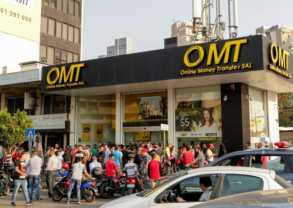 A big queue formed outside this money transfer shop in Beirut
