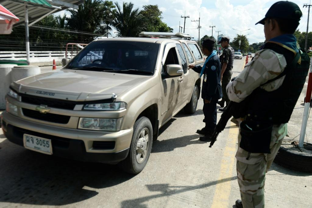 Armed civil defence volunteers and police have been searching vehicles at checkpoints in the southern province of Narathiwat