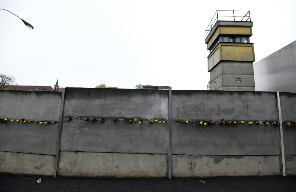 Flowers lining a section of the Berlin Wall that still stands, 30 years on