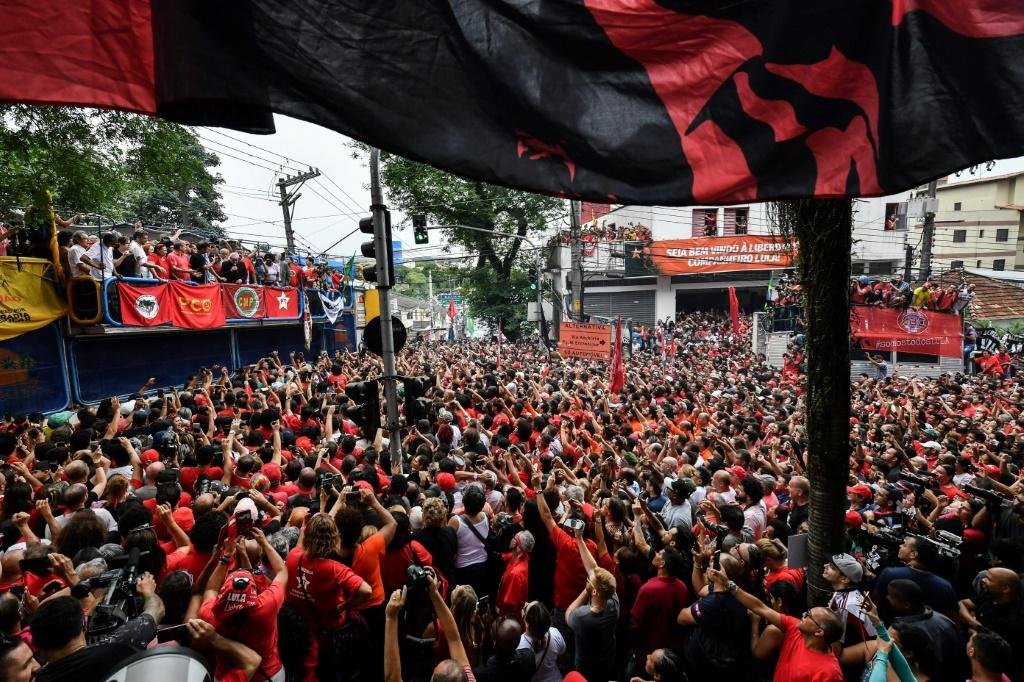 Supporters listen to Lula's address at a rally on November 9, 2019