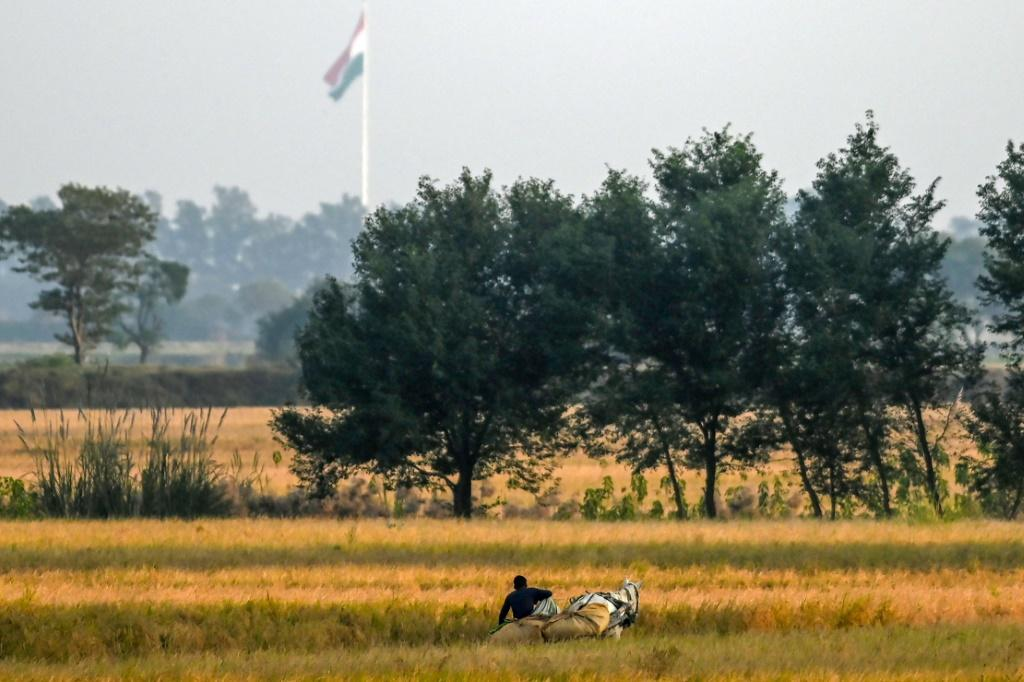 The Indian flag could be seen flying across the border, just beyond fields dotted with eucalyptus and guava trees