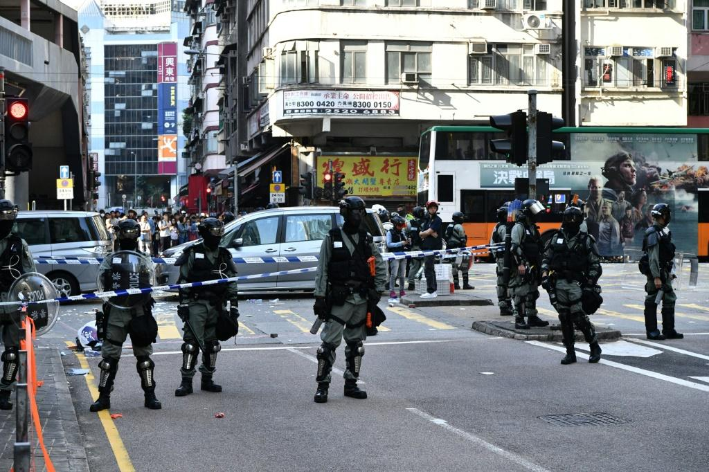 Hong Kong police shot a protester on Monday in the latest escalation in the city's political crisis