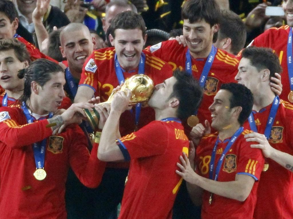 Finest hour: David Villa kisses the World Cup after Spain's victory in 2010