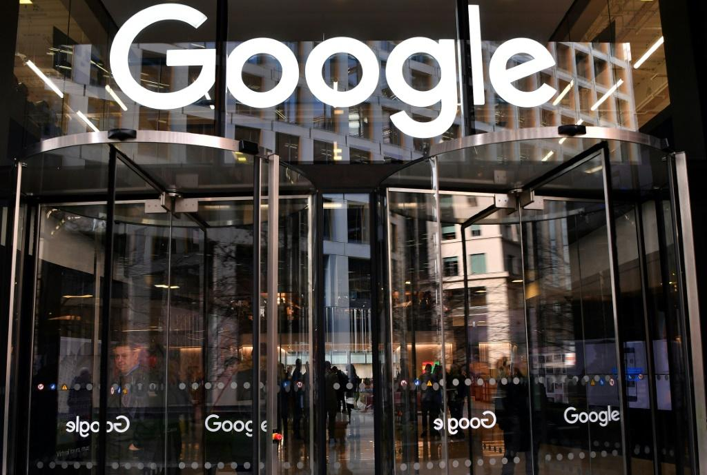 In this file photo taken on January 18, 2019 a logo is pictured above the entrance to the offices of Google in London