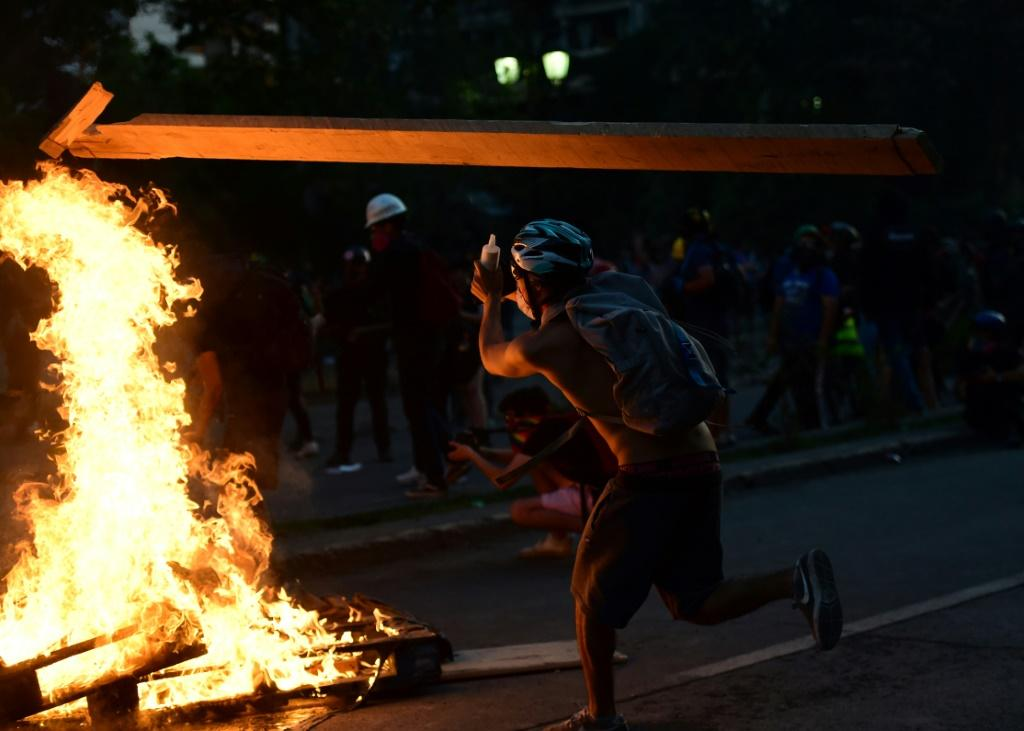 A demonstrator takes part in a protest against the government in Santiago, Chile on November 14, 2019