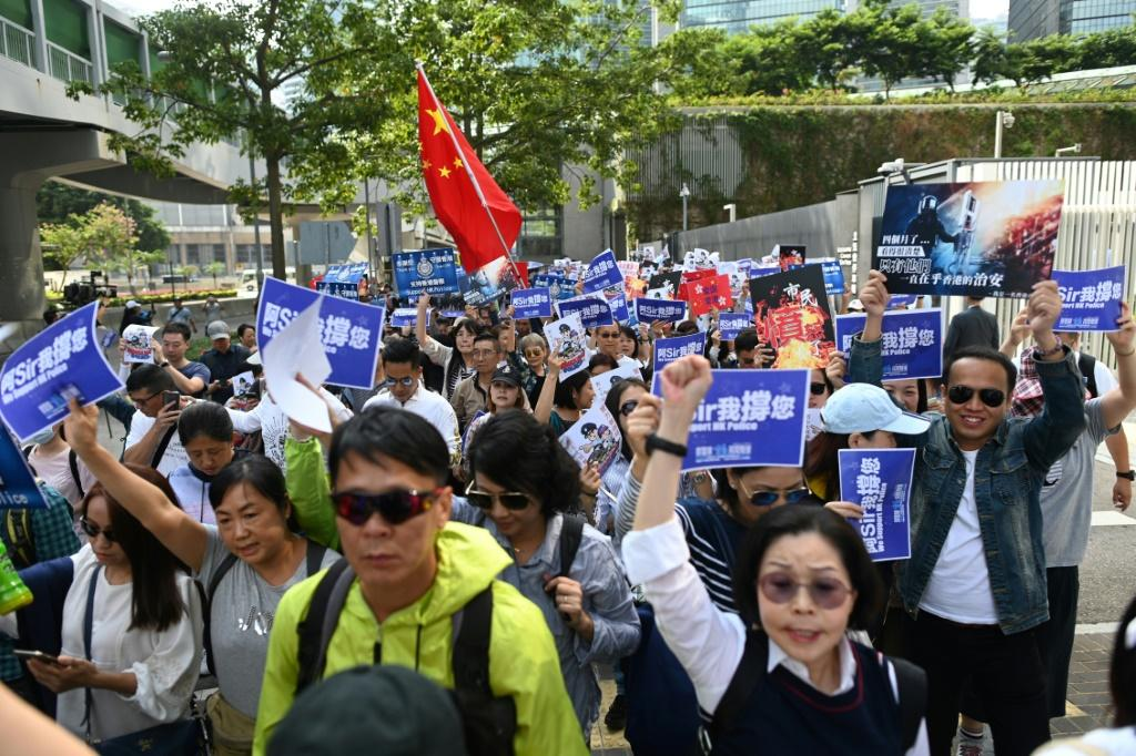 A group of around 500 people staged a rally near the government headquarters in support of the Hong Kong police force