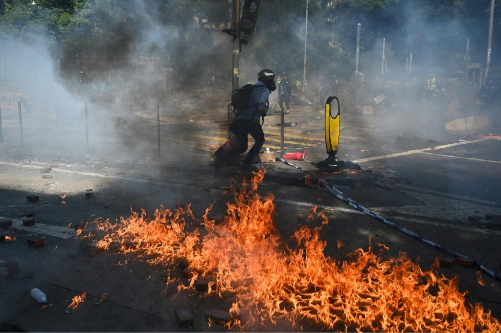 Hardline protesters in Hong Kong threw molotov cocktails shortly before 10.30 am after police fired tear gas