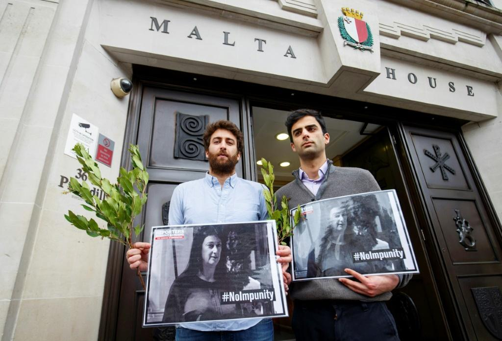 Caruana Galizia's sons Matthew and Paul at a vigil in London hoping for justice for their journalist mother