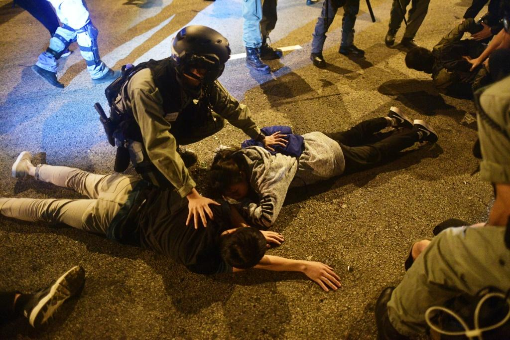 Police detain protesters and students after they attempted to escape from Hong Kong Polytechnic University campus and from police in the Hung Hom district of Hong Kong on November 19
