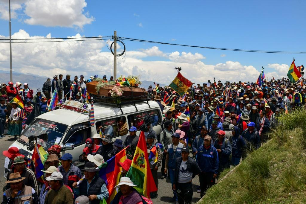 A funeral procession of eight supporters of Bolivia's ex-President Evo Morales, killed when security forces lifted a siege on a fuel plant
