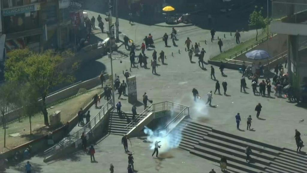 IMAGESBolivian riot police fire tear gas to break up a massive funeral procession that turned into an anti-government demonstration as Congress debated when to hold new elections.