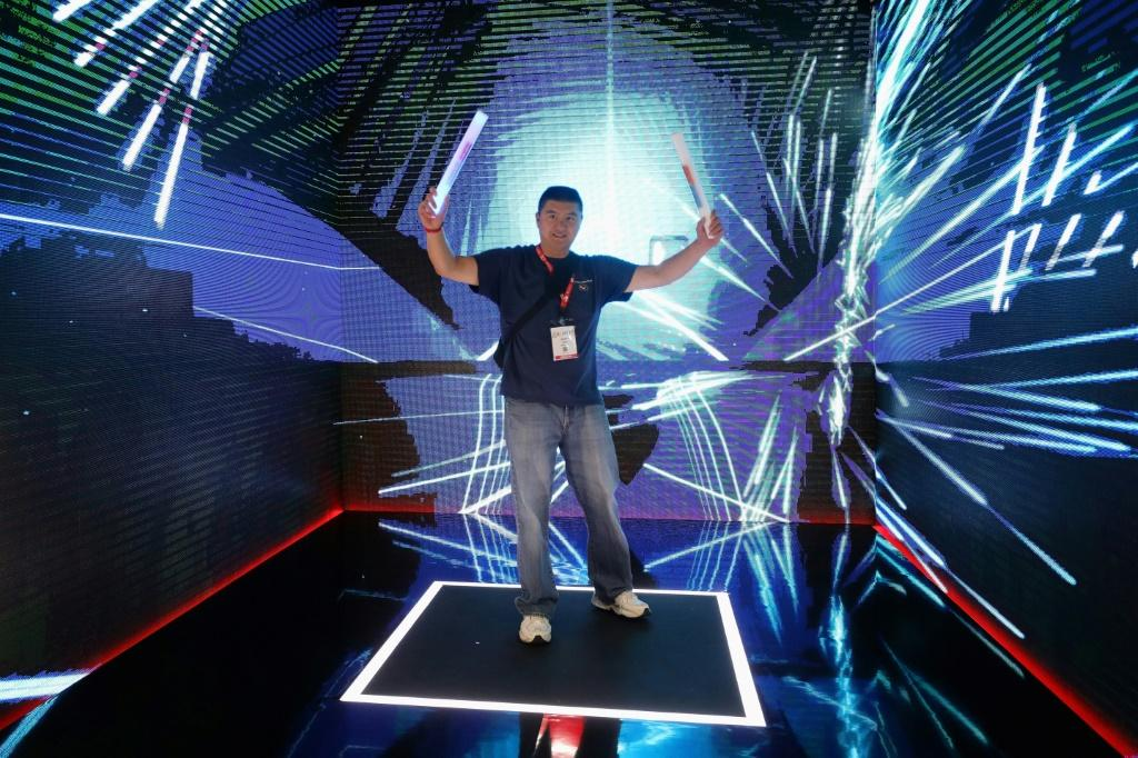 """A man plays """"Beat Saber"""" during the E3 Video Game Convention in Los Angeles in June 2019"""