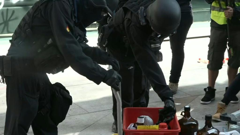 IMAGESHong Kong police look for petrol bombs and other dangerous materials after entering a ransacked university campus where authorities faced off for days with barricaded pro-democracy protesters.
