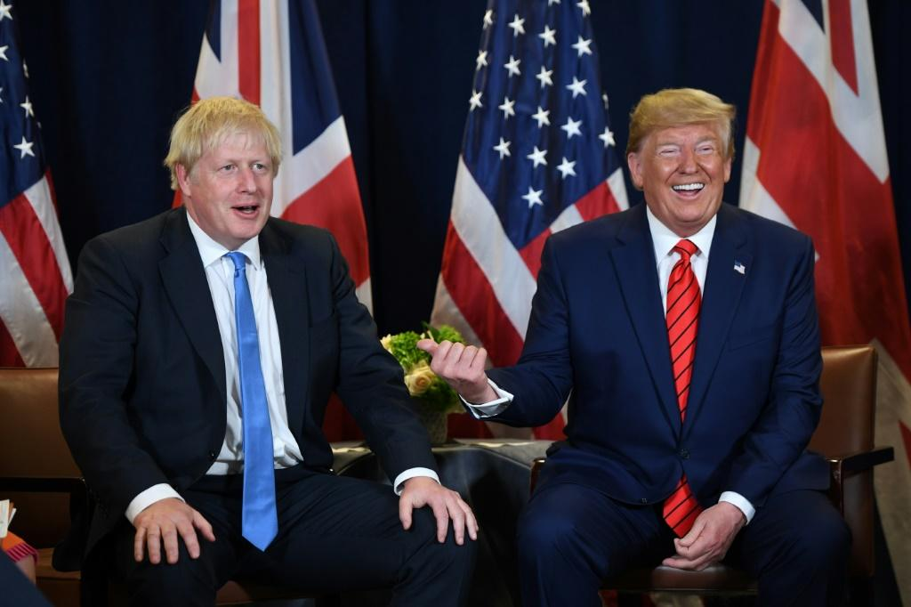 Labour said it had obtained documents proving Boris Johnson (L) was plotting a post-Brexit deal with Donald Trump to grant US firms access to the NHS