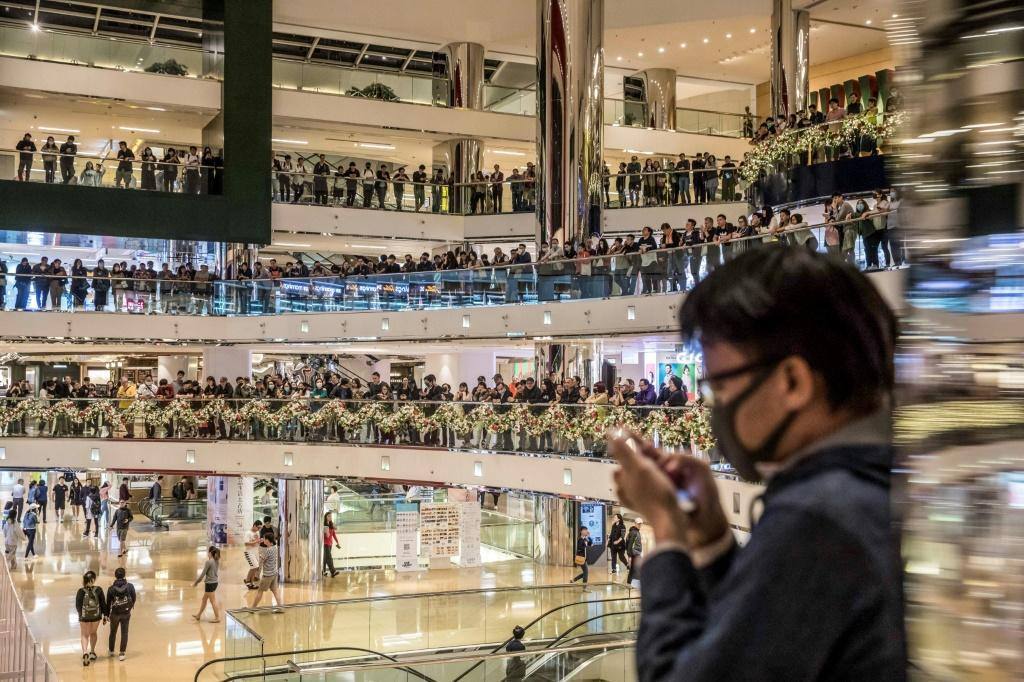 Pro-democracy protesters chant slogans in a shopping mall in Hong Kong on November 27, 2019