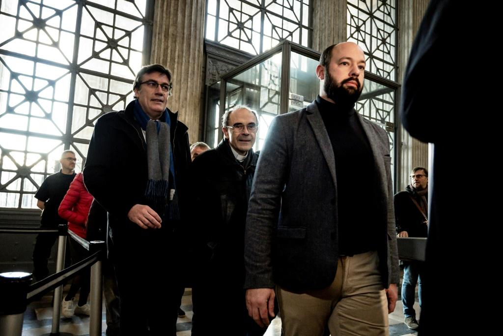 French cardinal Philippe Barbarin, centre, arrived at an appeal hearing in Lyon, France, on Friday to contest his six-month suspended sentence for failing to report sex abuse by a priest.