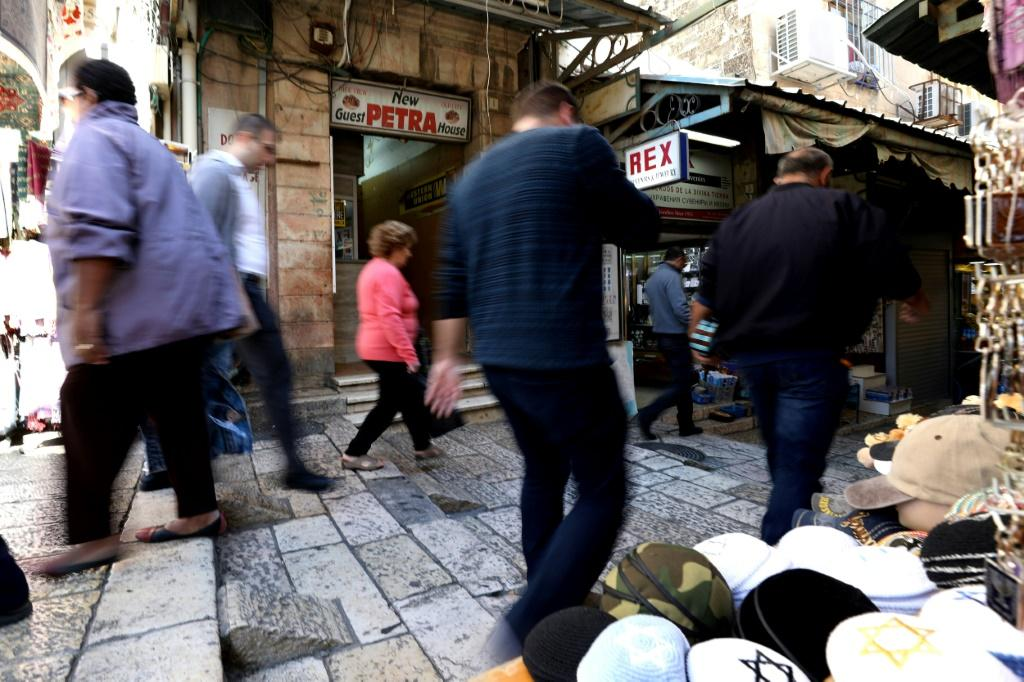 People walk past the Petra guest house located next to Jaffa Gate in the Christian quarter of Jerusalem's Old City, one of three disputed properties allegedly sold to an Israeli settlers association