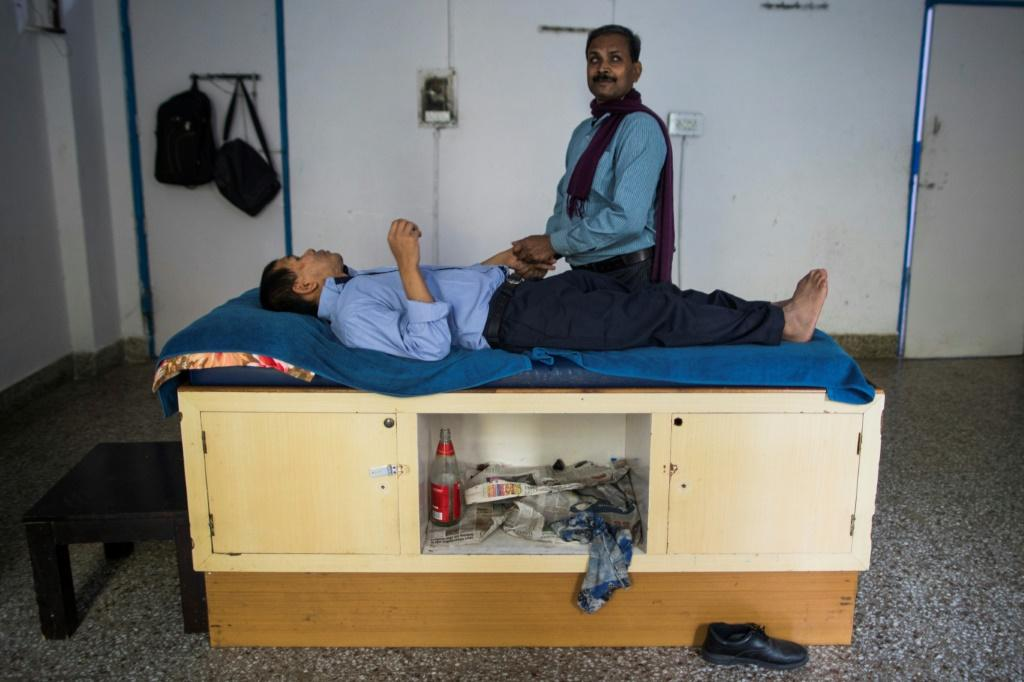 Blind Vinod Kumar Sharma has retrained as a massage therapist