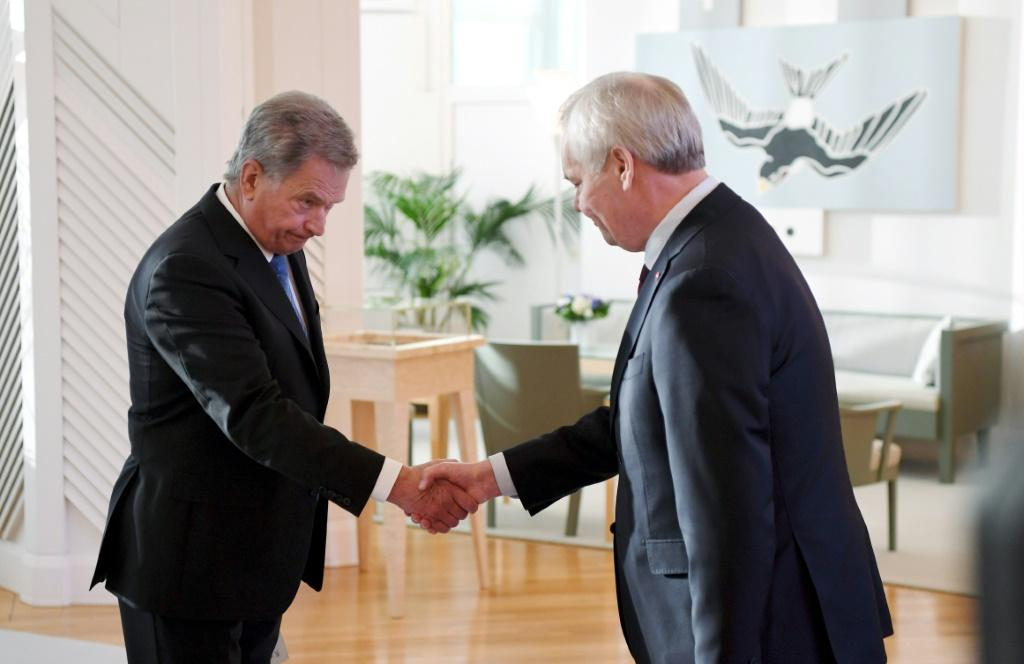 Rinne, right, resigns to the Finland's president